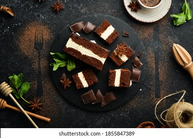 Chocolate cake with creamy mousse filling. Dessert. On a black background. Top view.