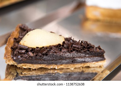 Chocolate cake created by Italian confectioners on the inspiration of the recipe of the Grandmother with chocolate cream and chocolate flakes to enhance the flavor of cooked pear Turin Italy May 2018