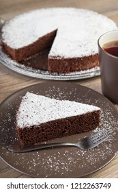 Chocolate cake with a cup of tea