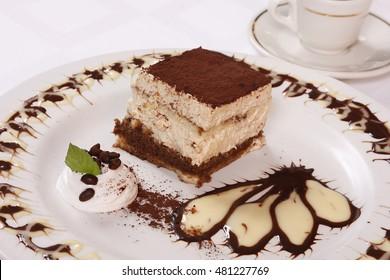 Chocolate cake with custard on the dessert plate.