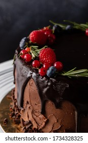 chocolate cake dessert with brown icing and fruits in rustic style