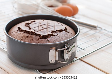 Chocolate cake in cake form on wooden background, Baking chocolate cake ingredients