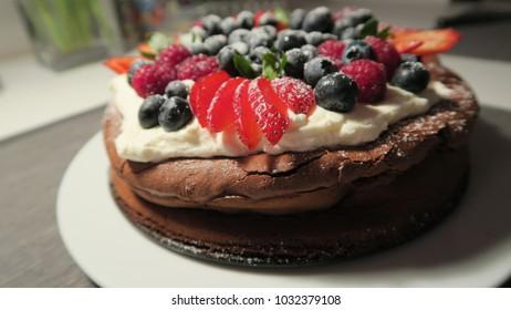 Chocolate cake with fruit: strawberries, blueberries, raspberries