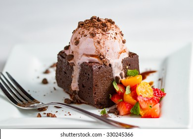 Chocolate cake with ice cream and berries