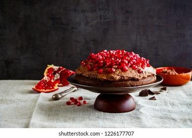 Chocolate cake with mascarpone cream and pomegranate