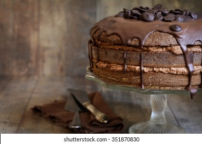 Chocolate cake with mascarpone on rustic background.