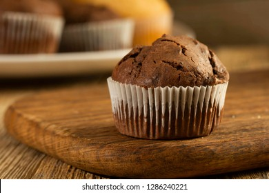 Chocolate cake and nut cake, homemade cakes on wooden background
