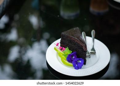 Chocolate cake on a beautiful white plate