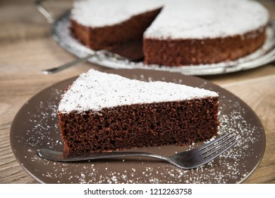 Chocolate cake on a brown plate