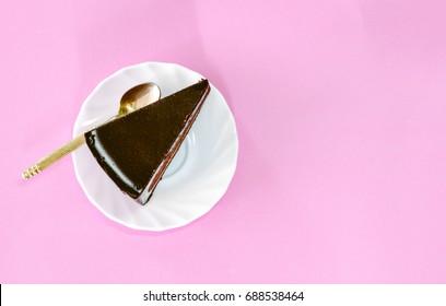 Chocolate cake on pink background
