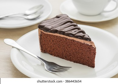 Chocolate cake on plate and coffee cup