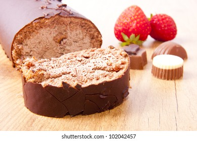 chocolate cake on the table with strawberries and chocolate