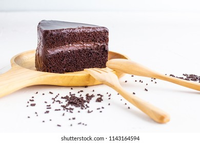 Chocolate Cake on wooden plate.