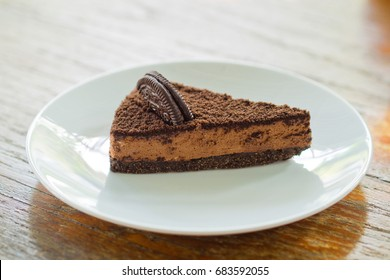 chocolate cake on wooden table background