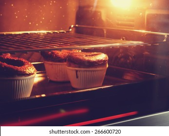 Chocolate cake in oven with vintage filter