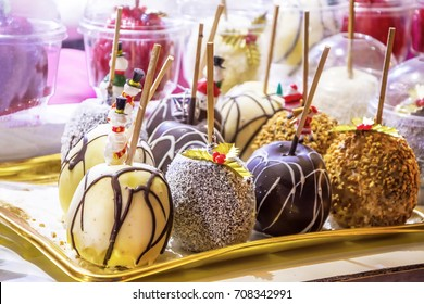 Chocolate cake pops in christmas market in Paris.