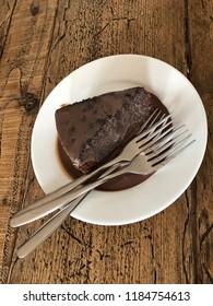 Chocolate cake served with creamy chocolate