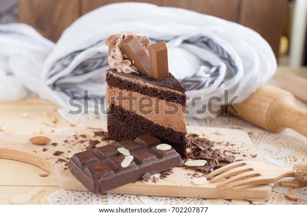 chocolate cake slice with chocolate cream and chocolate bar. cake background concept.