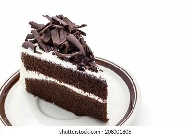 Chocolate cake slice on white background.