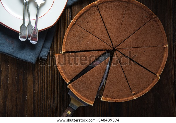 Chocolate cake sliced from above with fresh cocoa