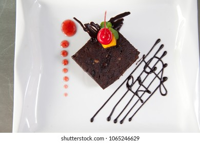 chocolate cake in small portion with cherry fruit