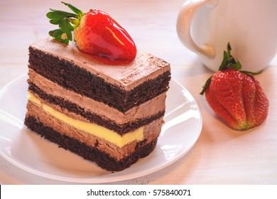 Chocolate cake with strawberries on a white table background / Selective focus