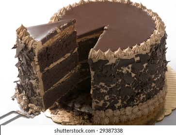 Chocolate cake in studio being sliced