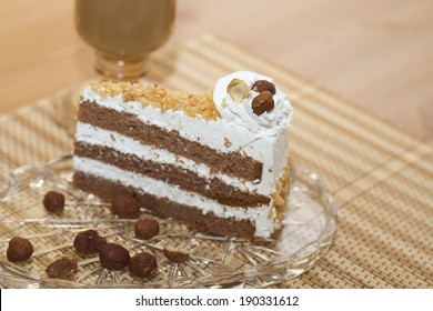 chocolate cake with whipped cream and nuts - Shutterstock ID 190331612