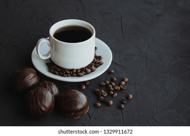 Chocolate cakes and cup of coffee on dark background