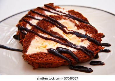 The chocolate cakes in heart form with vanila cream in the middle.