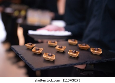 chocolate canapes on black stone tray