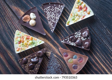 Chocolate candies with different toppings