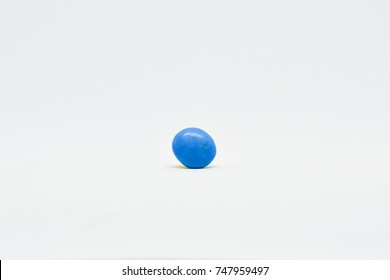 Chocolate candy blue color isolated white background