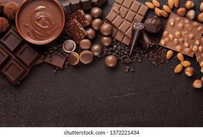 Chocolate candy box / Assortment of fine chocolates in white, dark, and milk chocolate and a bowl of melted chocolate