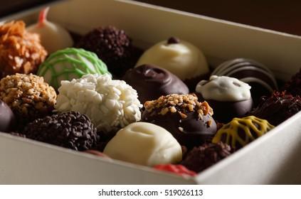 Chocolate candy box / Assortment of fine chocolates in white, dark, and milk chocolate.