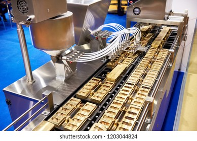 Chocolate candy making machine at confectionery factory