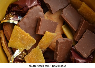chocolate, candy and mango in a plate