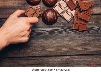 chocolate candy on a wooden background.