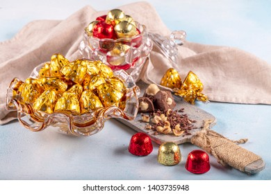 Chocolate candy in shiny wrapper. Delicious chocolate candies  on wooden background. Ramadan Eid (Ramadan feast) Concept.