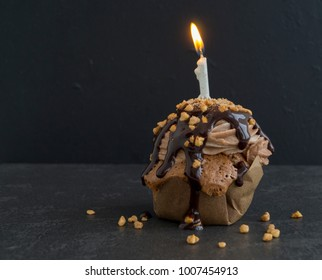 Chocolate capcake with a candle for the birthday.
