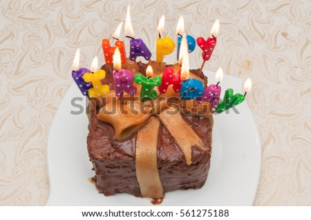 Chocolate Caramel Birthday Cake Wraped In Gift Ribbon With Happy Written Candles Lighted Kerala India