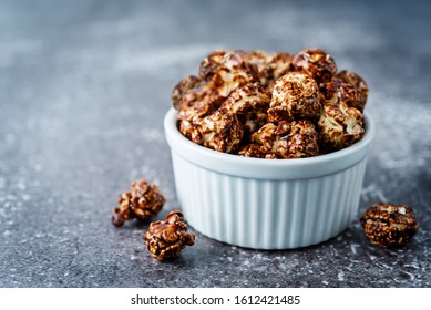 Chocolate caramel sweet Popcorn in a white bowl. toning. selective focus