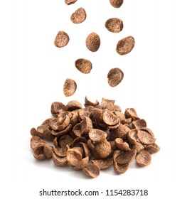 Chocolate cereals falling isolated on white background.