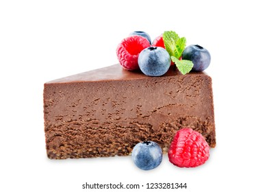 Chocolate cheesecake with fresh berries and mint leaves isolated. the toning. selective focus