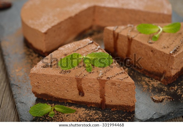 Chocolate cheesecake on a wooden background