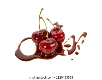 Chocolate cherries on a white background