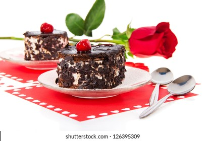 Chocolate cherry cakes and red rose in Valentine's day isolated on white