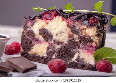 Chocolate cherry fruit cake. Piece of sweet pie and frosen cherry on white background.