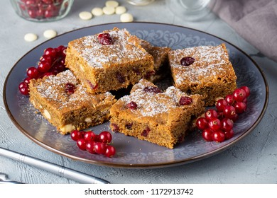 Chocolate Chip Blondies Cut Into Squares, decorated red currant on plate