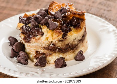 Chocolate chip bread pudding on white plate